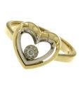 anello a cuore in oro giallo e oro bianco