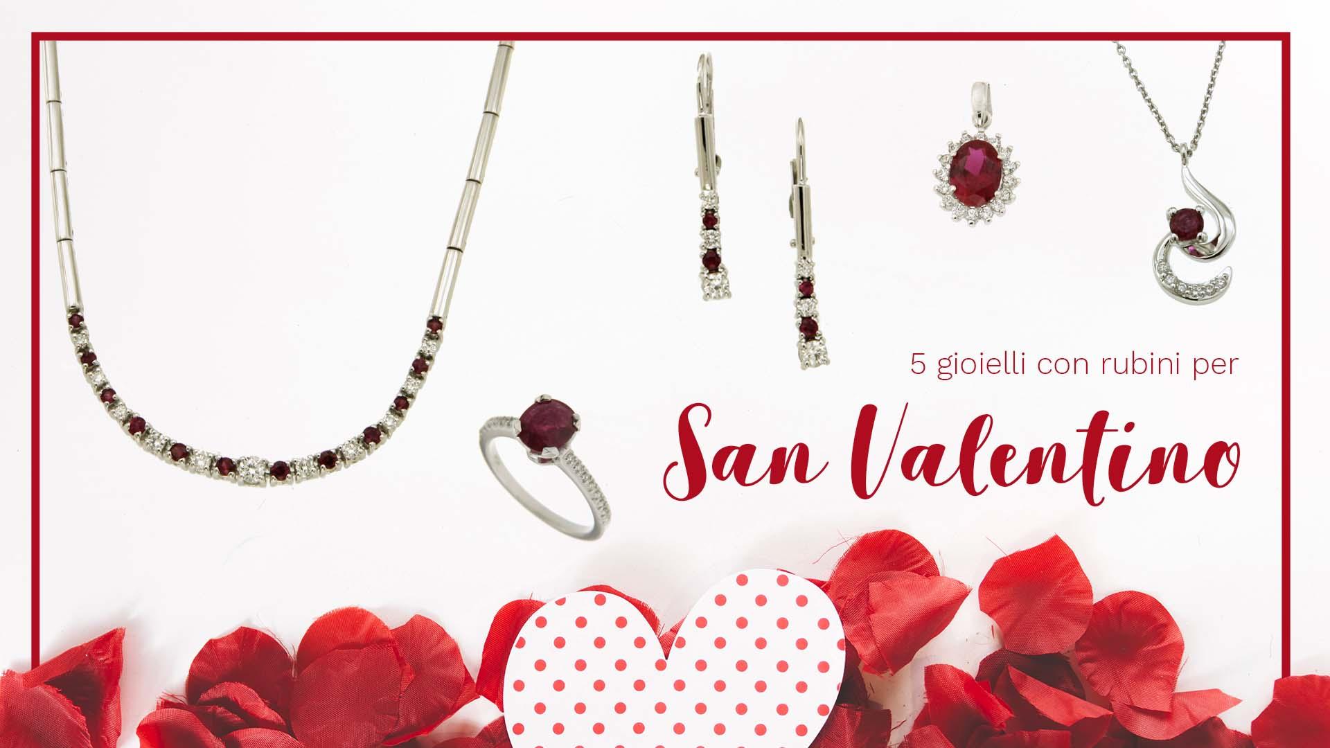 Gioielli con rubini per San Valentino: gioielli su sfondo bianco con petali di rose e cuore di carta